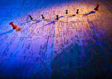 Thumb tacks on a map