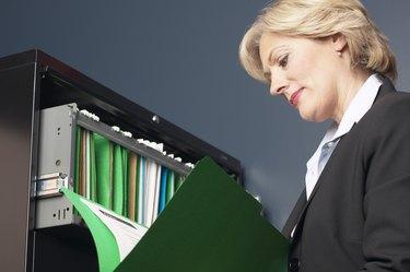 Woman reading file