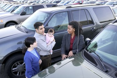 Saleswoman and family car shopping