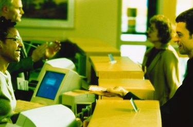 Customer Giving a Bank Teller Money