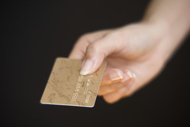 Woman paying with a credit card