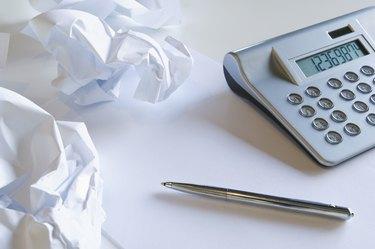 Crumpled paper and calculator