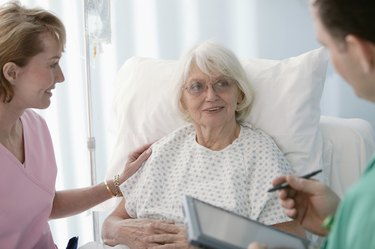 Patient talking to physicians at hospital