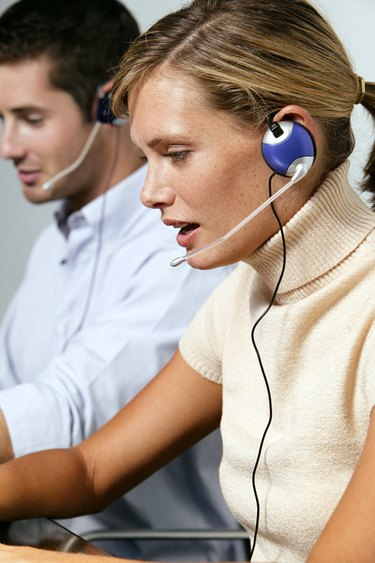 Customer service representatives with headsets