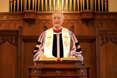 A minister giving a sermon at the pulpit in church.