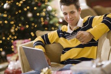 Teenage boy using laptop computer at Christmas