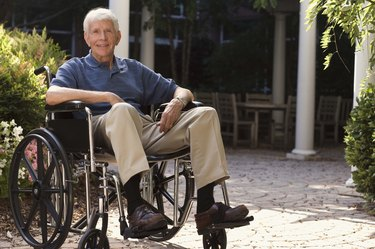 Elderly man in wheelchair outdoors