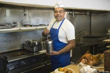 Hispanic male cook in kitchen