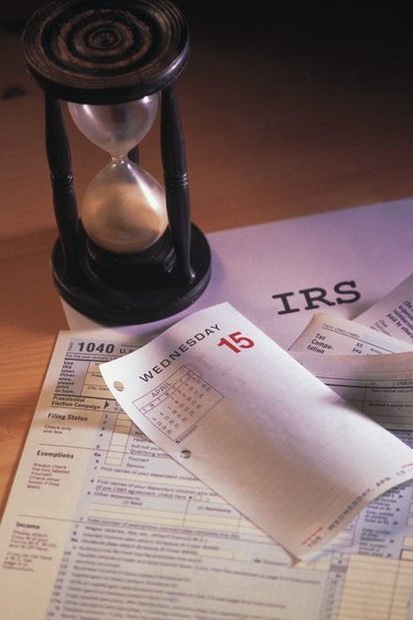 Hourglass and tax forms