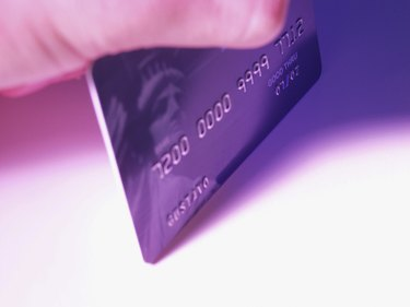 Close-up of hand holding a credit card