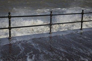 Water crashing over rail
