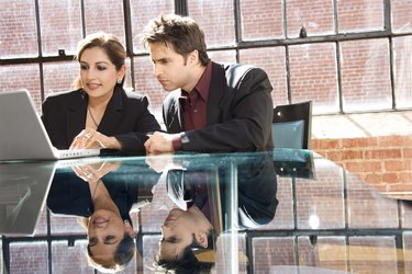 Professional man and woman with laptop