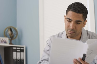 Businessman with paper documents