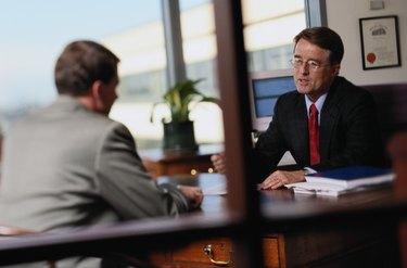 Businessmen Talking in an Office