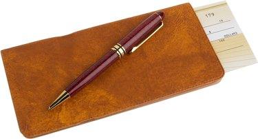 Checkbook and pen