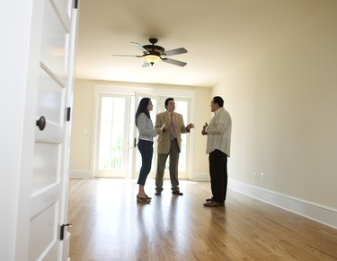 Couple with realtor looking at new home