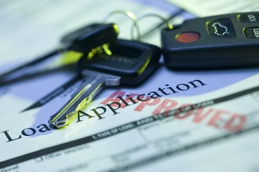 Car keys and approved loan application