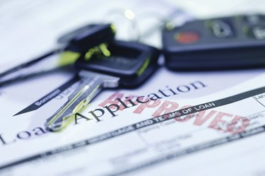 Approved loan application with car keys