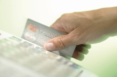 Person sliding credit card