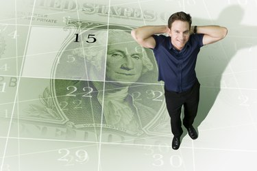 Man standing on calendar decorated with dollar bill