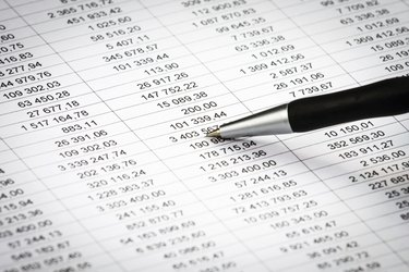 Businessman showing diagram on a financial report using pen