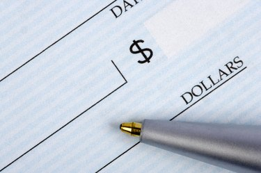 Closeup of check with pen