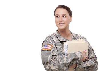 Female soldier with folder looking away