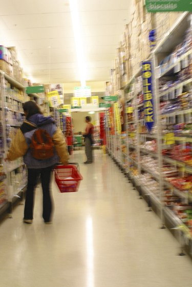 A typical Melbourne Supermarket. A shopper awaits their groceries to be put through the checkout.  2003