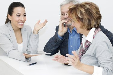 Mature Couple in Meeting With Advisor