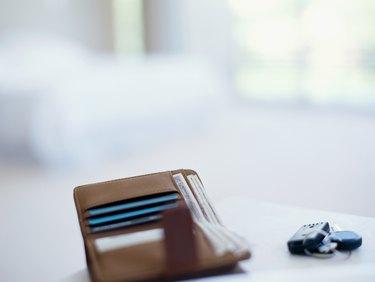 close-up of a wallet and car keys