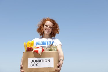 volunteer with donation box