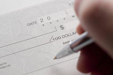 Business woman prepare writing a check