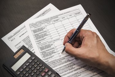 Man fills out polish tax form