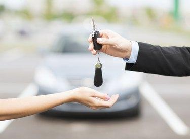 customer and salesman with car key