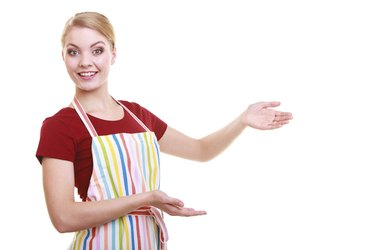 housewife waitress inviting welcome gesture kitchen apron isolated