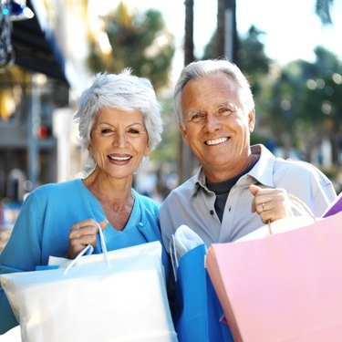 portrait of a mature couple carrying shopping bags