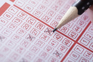 Person Marking Number On Lottery Ticket