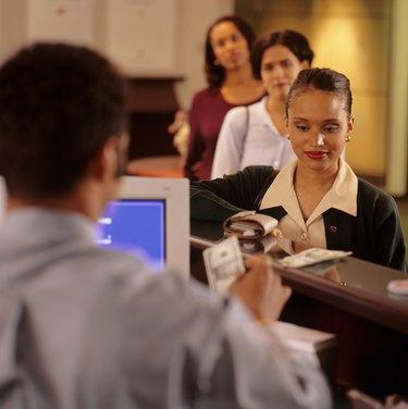 Woman withdrawing money at bank