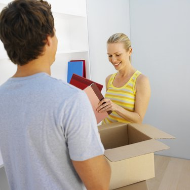 Young couple unpacking boxes