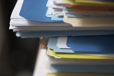 Corner of stack of files, close-up