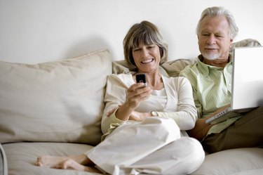 Couple with a laptop and cell phone