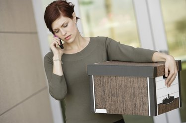 Businesswoman Using Mobile Phone with Moving Box