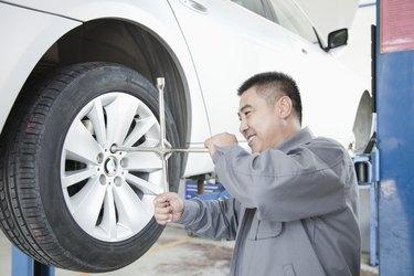 Mechanic Adjusting Tire