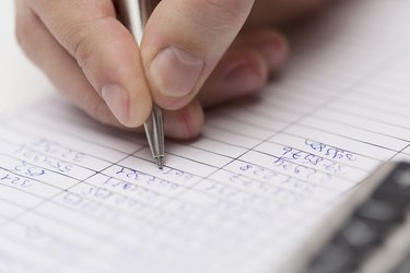 close up of businessman with papers and calculator