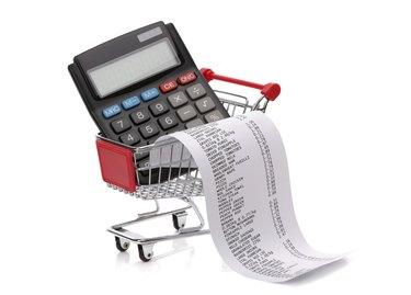 Shopping till receipt, calculator and cart