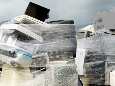 Shrink wrapped pile of electronics computer waste