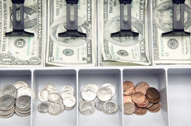 Open cash drawer with money