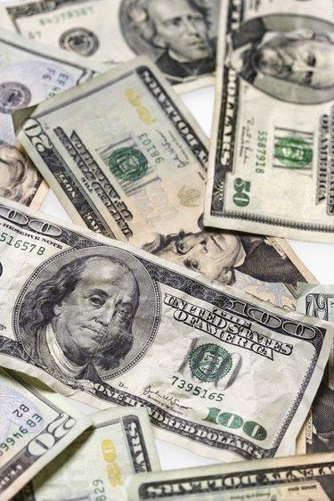 Dollar bills of various denominations