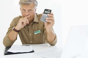Financial adviser with calculator