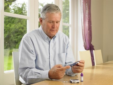 Man using glucometer for diabetes